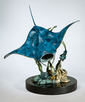 """Ocean Aviator"" Cast bronze manta ray, octopus, moray eel and fish school on a black marble base"